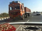 Trucks in India are brightly coloured, adorned with decorations of religious symbols and music blares full-blast for everyone to hear they are on the road