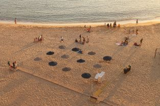 "Don't you just love the neat geometric umbrellas on the beach - this is the ""Praia dos Pescadores"" (directly translated as ""The Fishermens' Beach"""
