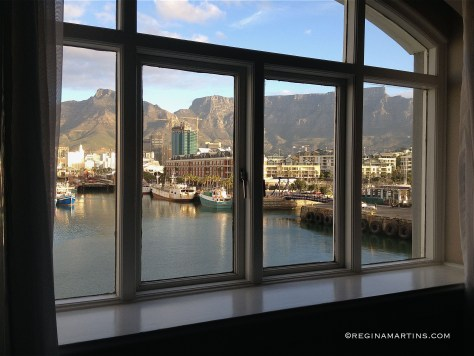 Table Mountain as seen from the shadows of a room