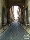 A narrow road through an archway ©2016 Regina Martins