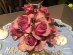 Real red roses atop my sister's birthday cake ©2016 Regina Martins