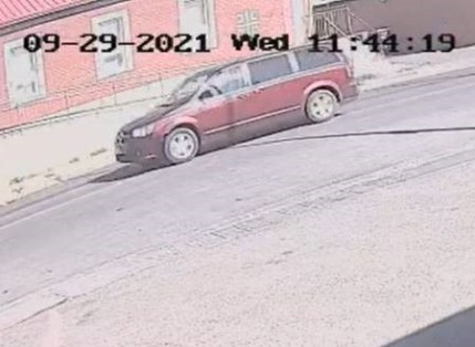 The vehicle is a red Dodge Caravan, with Saskatchewan license plate number T1910