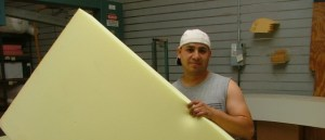 Soft new flame retardant free foam, ready for its second cut. At Foam Order, a furniture retailer in San Francisco.