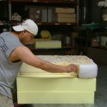 Saul matches the shape of the new, flame retardant free polyurethane foam to the old, flame retardant-containing foam. The new foam will be cut along the drawn line, and inserted into the old casing. The operation took place at Foam Order, one of five furniture retailers participating in Safer Sofa Foam Exchange program in San Francisco Bay Area.