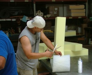 Saul Ordonez works with flame retardant free foam at Foam Order, one of five stores participating in the Safer Sofa Foam Exchange.