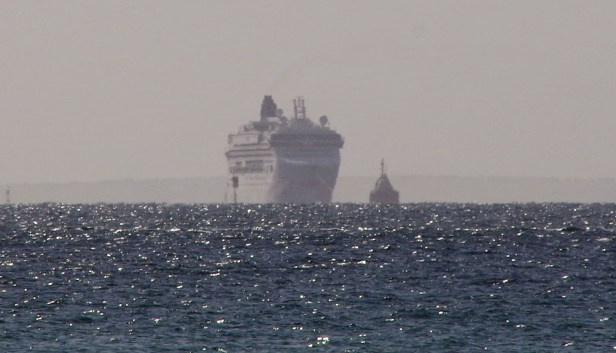 The Norwegian Star being towed back to port