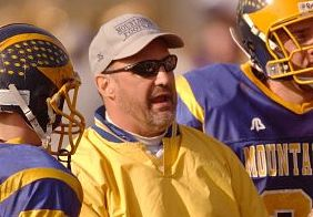 Winsted, CT 11/27/03 1127J07.03 Houatonic head coach Mike DeMazza talks with his players during their Thanksgiving Day game against Gilbert at Gilbert High School in Winsted. Jim Shannon Phtoo