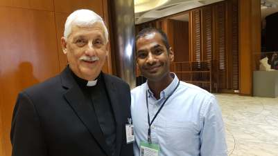 Fr General poses with Prevain Devendran