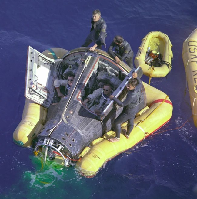 Astronauts Neil Armstrong and David R. Scott sit with their spacecraft hatches open while awaiting the arrival of the recovery ship, the USS Leonard F. Mason, after the successful completion of their 1966 Gemini 8 mission. Pic: NASA