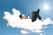 man relaxes on cloud