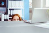 Someone peeking over their desk out of sight