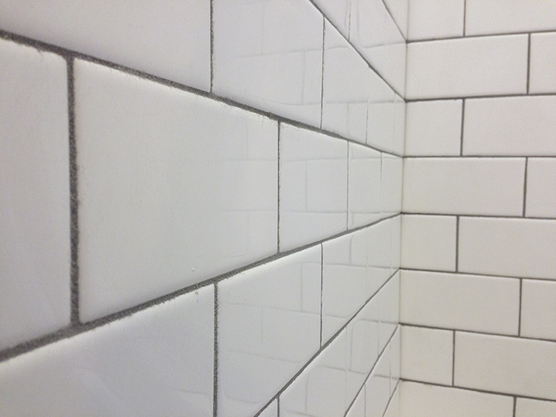 Installing subway tile in a Victorian bathroom.