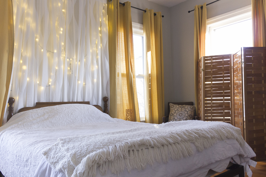A simple design solution for a bedroom. Add curtains behind the bed.