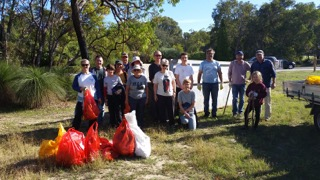 Participants in front of a large skip bin with rubbish collected from within the reserve.