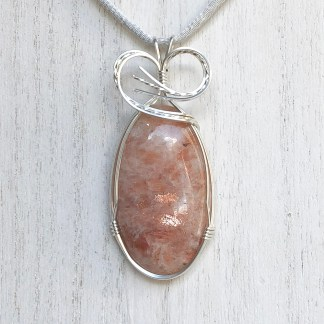 reiki charged sunstone pendant