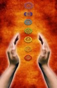 open female hands holding between them chakras symbols