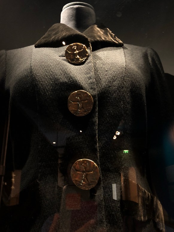 Giacometti button on Schiaperelli jacket, property of Marlene Dietrich, Musee des Arts Decoratifs, Paris.
