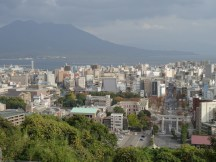Overview over Kagoshima in the very south of Japan. Vulcano Sakurajima in the background.