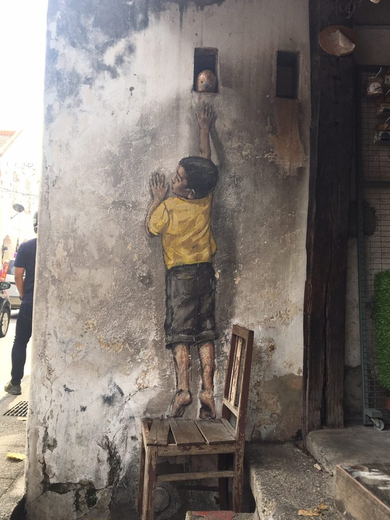 Street art George Town Penang Malaysia boy chair