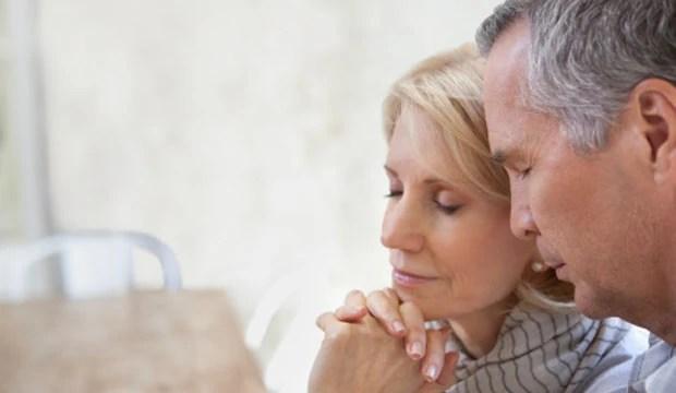 Close up of older couple praying together