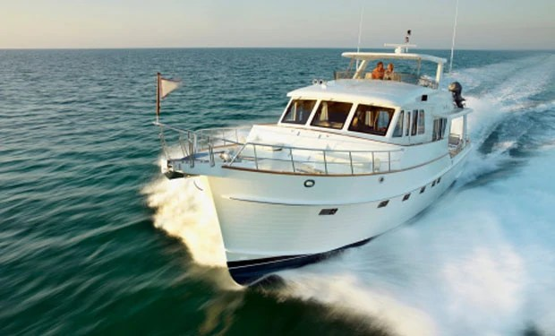 Couple on yacht powering through sea