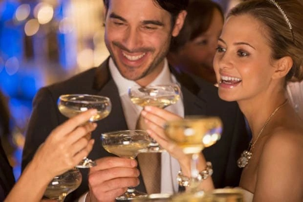 Close up of couple toasting champagne glasses