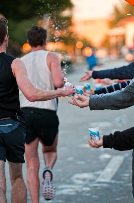 Runners taking water