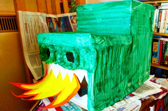 Cardboard Box Dragon Craft - Halfway through with nostrils, teeth & flames coming from it's mouth.