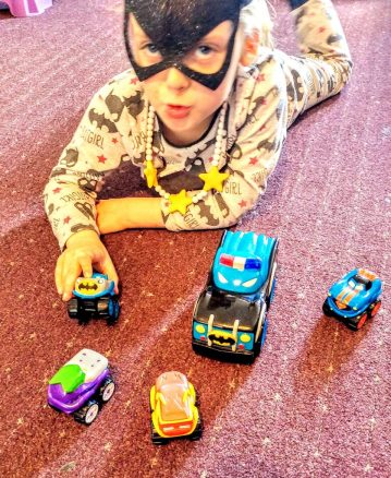 Izzy playing with Herodrive vehicles