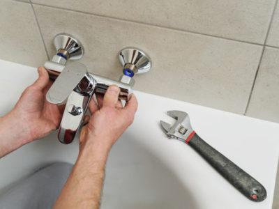 plumber in Loveland, CO installs a bathtub spigot