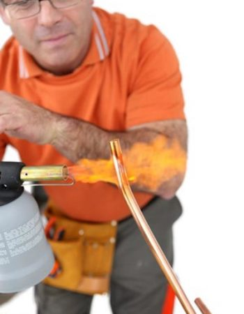 Relief Home Services Plumber soldering new copper water line