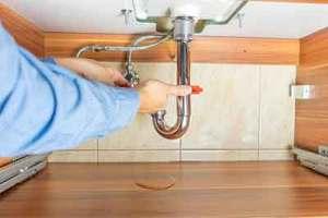 plumber repairing a leak in Loveland