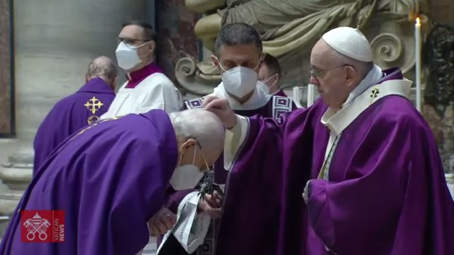 Pope Francis, right, places ash on the head of clergy members during Ash Wednesday Mass at the Vatican, on Feb. 17, 2021. Video screengrab via Vatican News