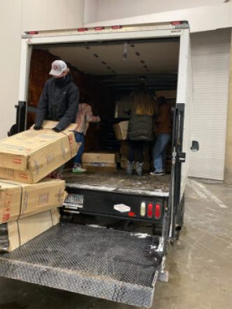 Cots are unloaded for an emergency warming center at Kay Bailey Hutchison Convention Center in Dallas, Monday, Feb. 15, 2021. Photo courtesy of Ali Hendricksen/OurCalling