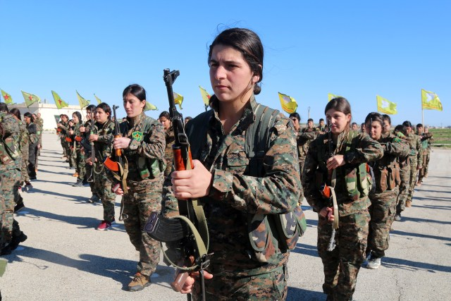 "All-female militia fighting against the Islamic State stand in formation. Photo courtesy of ""The Daughters of Kobani"""