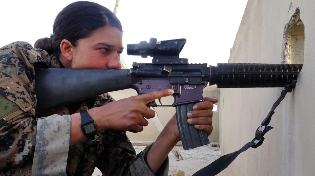 "A YPJ sharpshooter scans for IS fighters. Photo courtesy of ""The Daughters of Kobani"""