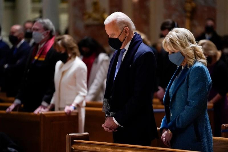 In this Jan. 20, 2021, file photo, President-elect Joe Biden and his wife, Jill Biden, attend Mass at the Cathedral of St. Matthew the Apostle during Inauguration Day ceremonies in Washington.(AP Photo/Evan Vucci)