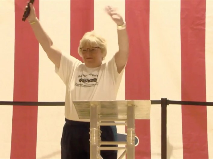 Dr. Sherri Tenpenny waves to the crowd at Bards Fest in St. Louis. Video screengrab