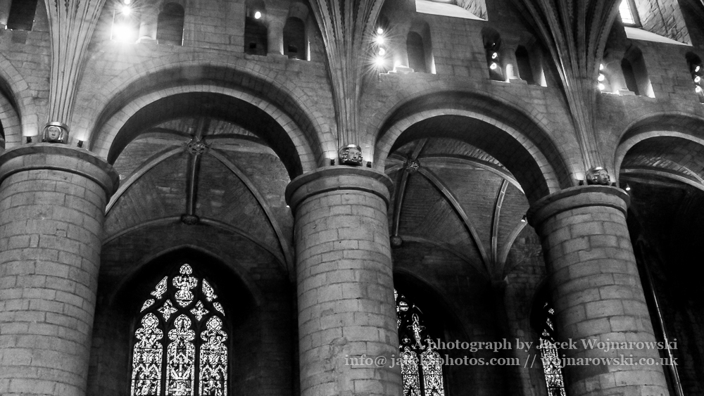 Romanesque arches in Tewkesbury Abbey Nave black and white photography high contrast