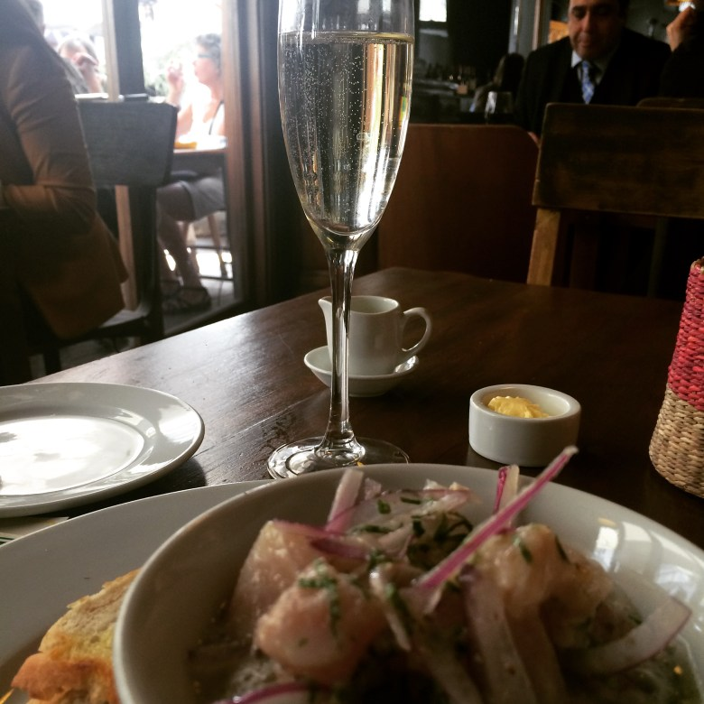 A glass of Spumante and ceviche.