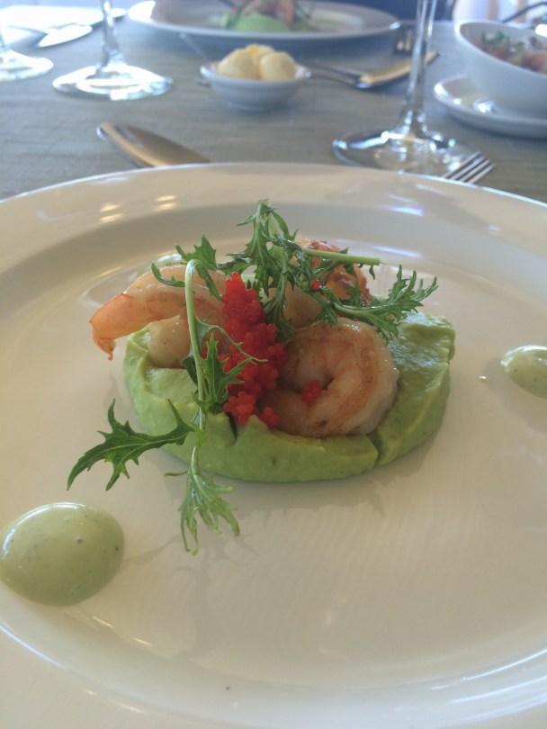 Shrimp on fava bean purée.