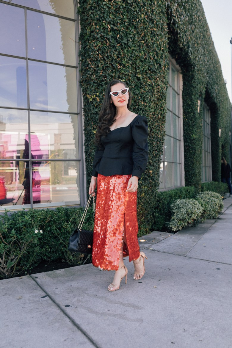 Los Angeles blogger, RELish By Arielle, wears a red sequins skirt and black top from Zara