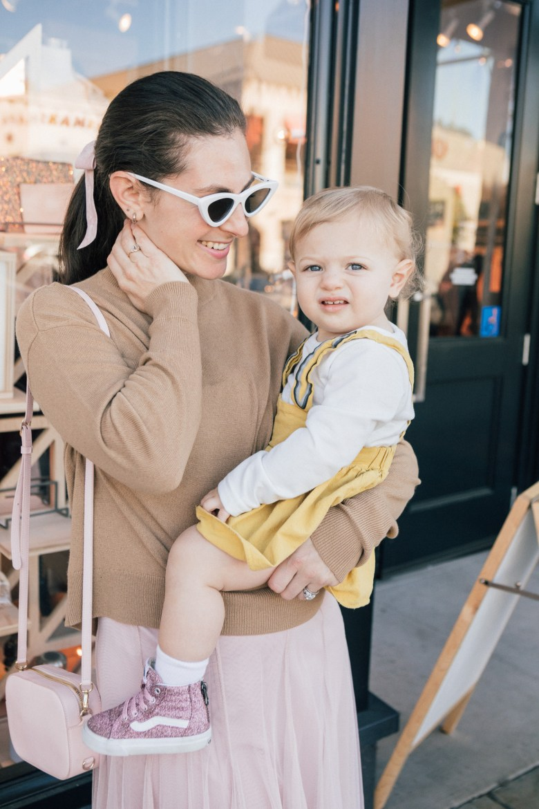 LA blogger, RELish By Arielle, styles her baby in a yellow bunny jumper
