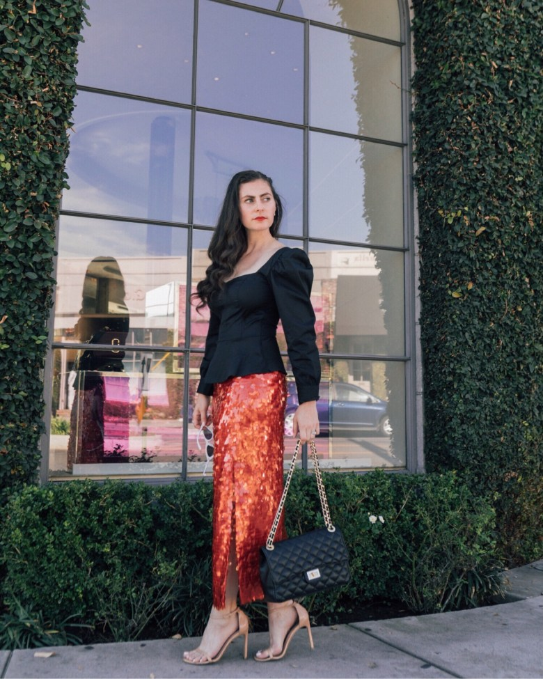 Los Angeles blogger, RELish By Arielle wears a red sequin skirt from Zara