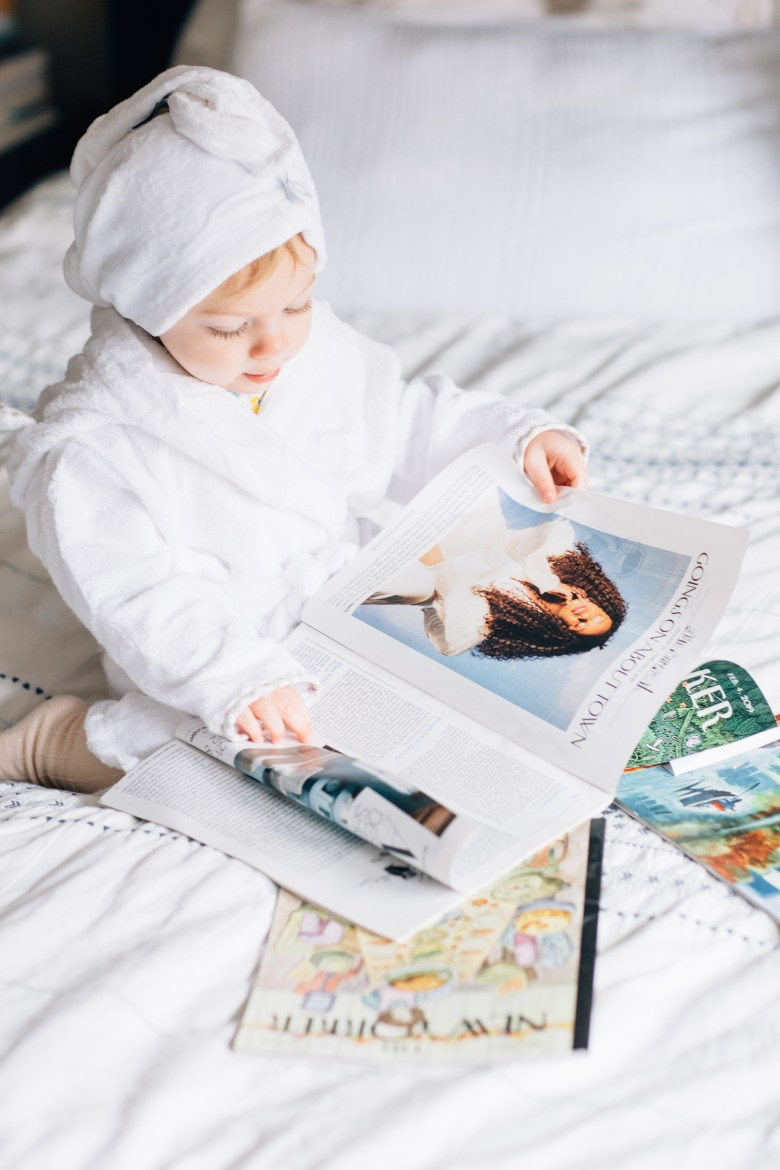 Los Angeles fashion blogger, RELish By Arielle's daughter reads magazines in a bathrobe for Valentine's Day