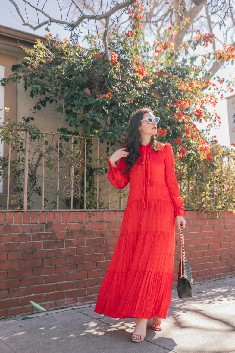 Los Angeles style and mom blogger, RELish By Arielle, wears a red maxi dress from Zara