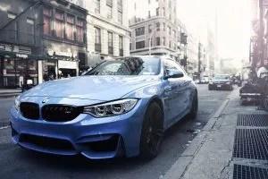 A blue car on the street.