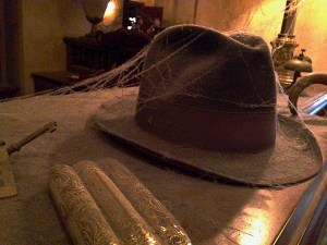 The cigars and hat left behind.