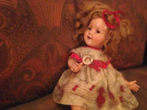 A Shirley Temple doll left behind by the ghostly child.  She didn't forget her Mickey Mouse doll however!