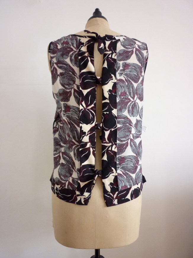 This is the garment outside in. It clearly shows the generous amount of fabric in the facing.